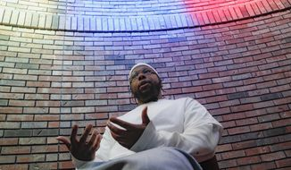 """In this Oct. 23, 2019 photo, Myon Burrell speaks at the Stillwater Correctional Facility in Stillwater, Minn. A Minnesota prosecutor said Monday, Feb. 24, 2020 his office has spent weeks reviewing a murder conviction raised by Amy Klobuchar on the presidential debate stage, saying he believes the evidence that sent a black teenager to prison for life was """"quite strong."""" Hennepin County Attorney Mike Freeman said he would meet soon with attorneys for Burrell, who was 16 when he was arrested in the 2002 shooting that killed an 11-year-old girl, and with representatives of the Innocence Project. (AP Photo/John Minchillo)"""