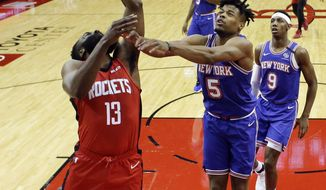 Houston Rockets guard James Harden (13) shoots as New York Knicks guard Dennis Smith Jr. (5) defends during the first half of an NBA basketball game, Monday, Feb. 24, 2020, in Houston. (AP Photo/Eric Christian Smith)