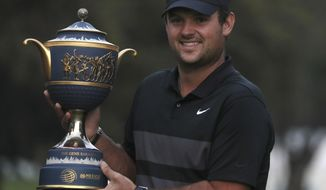 Patrick Reed of the United States poses with the trophy after winning the WGC-Mexico Championship golf tournament, at the Chapultepec Golf Club in Mexico City, Sunday, Feb. 23, 2020. (AP Photo/Fernando Llano) ** FILE **