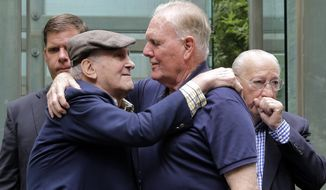 FILE - In this July 11, 2017, file photo, Holocaust survivor Steve Ross, left, founder of the New England Holocaust Memorial, embraces former Boston Mayor Raymond Flynn during a a rededication ceremony for the repaired New England Holocaust Memorial in Boston. Ross, a Holocaust survivor who spent decades searching for the soldier who helped him at a concentration camp in 1945, died Monday, Feb. 24, 2020, Boston Mayor Marty Walsh said in a tweet. (AP Photo/Elise Amendola, File)