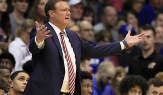 Kansas head coach Bill Self questions a call during the first half of an NCAA college basketball game against Oklahoma State in Lawrence, Kan., Monday, Feb. 24, 2020. (AP Photo/Orlin Wagner)