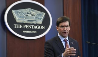 In this Dec. 20, 2019, file photo Defense Secretary Mark Esper speaks during a news conference at the Pentagon in Washington. The Pentagon is adopting new ethical principles as it prepares to accelerate its use of artificial intelligence technology on the battlefield. (AP Photo/Susan Walsh) **FILE**
