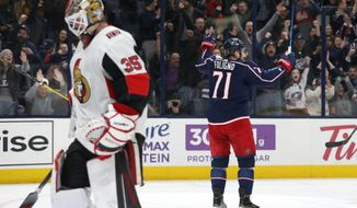 Columbus Blue Jackets' Nick Foligno, right, celebrates his goal against Ottawa Senators' Marcus Hogberg, left, of Sweden, during the second period of an NHL hockey game Monday, Feb. 24, 2020, in Columbus, Ohio. (AP Photo/Jay LaPrete)