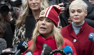 Actor Rosanna Arquette speaks as actor Rose McGowan, right,  listens at a news conference outside a Manhattan courthouse after the arrival of Harvey Weinstein, Monday, Jan. 6, 2020, in New York. Weinstein is on trial on charges of rape and sexual assault, more than two years after a torrent of women began accusing him of misconduct. (AP Photo/Mark Lennihan)
