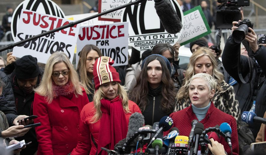 FILE - In this Jan. 6, 2020, file photo, Actor Rose McGowan, right, speaks at a news conference as actor Rosanna Arquette, center left, listens outside a Manhattan courthouse after the arrival of Harvey Weinstein in New York. (AP Photo/Mark Lennihan, File)