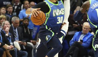 Dallas Mavericks guard Seth Curry (30) drives the ball against Minnesota Timberwolves guard D'Angelo Russell in the first half during an NBA basketball game on Monday, Feb. 24, 2020, in Dallas. (AP Photo/Richard Rodriguez)