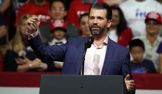 In this Feb. 19, 2020, photo, Donald Trump Jr. speaks at a rally before his father, President Donald Trump, appears in Phoenix. (Associated Press) **FILE**
