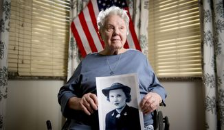 In this Wednesday, Feb. 19, 2020 photo, Olive O'Mara, a veteran who served as an engineer on a naval ship as part of the U.S. Navy's WAVES program during World War II, poses for a portrait at River Meadows Senior Living in Alpine, Utah. O'Mara was born on Saturday, Feb. 21, 1920. (Isaac Hale/The Daily Herald via AP)