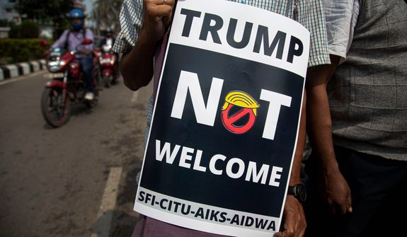 An Indian activist holds a placard during a protest against U.S. President Donald Trump during his India visit, in Gauhati, India, Monday, Feb. 24, 2020. Indian Prime Minister Narendra Modis Hindu nationalist government is pulling out all the stops, at an expense of more than $14 million, to woo the president and first lady Melania Trump. But experts have said that very little of substance will be achieved for either side beyond the pageantry and symbolism. (AP Photo/Anupam Nath)