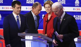 From left, Democratic presidential candidates, former South Bend Mayor Pete Buttigieg, former New York City Mayor Mike Bloomberg, Sen. Elizabeth Warren, D-Mass., and former Vice President Joe Biden, walk off stage at the end of the Democratic presidential primary debate at the Gaillard Center, Tuesday, Feb. 25, 2020, in Charleston, S.C., co-hosted by CBS News and the Congressional Black Caucus Institute. (AP Photo/Patrick Semansky)