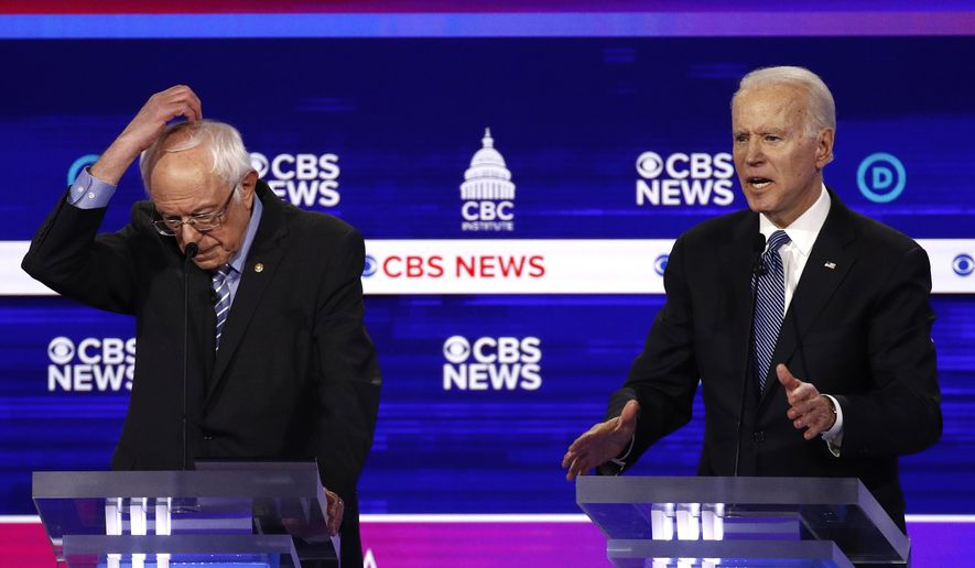 From left, Democratic presidential candidates Sen. Bernie Sanders, I-Vt., and former Vice President Joe Biden, participate in a Democratic presidential primary debate at the Gaillard Center, Tuesday, Feb. 25, 2020, in Charleston, S.C., co-hosted by CBS News and the Congressional Black Caucus Institute. (AP Photo/Patrick Semansky) ** FILE **