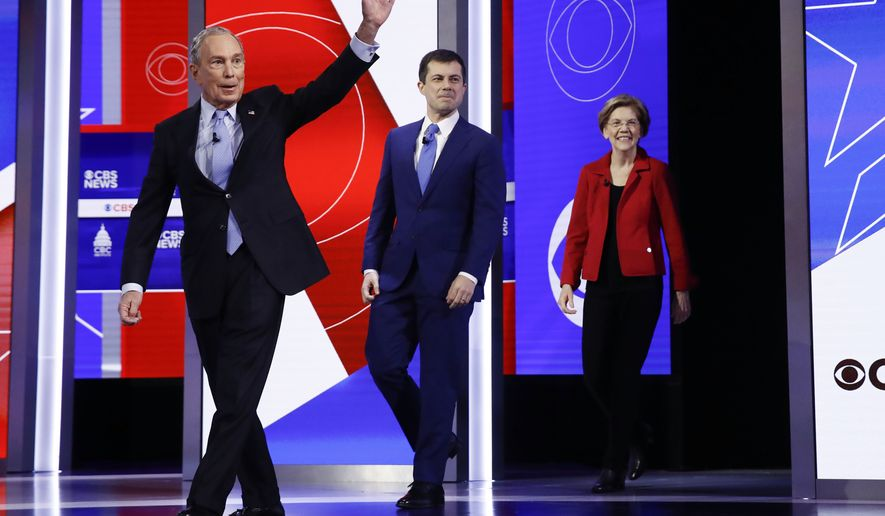 From left, Democratic presidential candidates, former New York City Mayor Mike Bloomberg, former South Bend Mayor Pete Buttigieg, and Sen. Elizabeth Warren, D-Mass., walk onto the stage to participate in a Democratic presidential primary debate, Tuesday, Feb. 25, 2020, in Charleston, S.C. (AP Photo/Matt Rourke)
