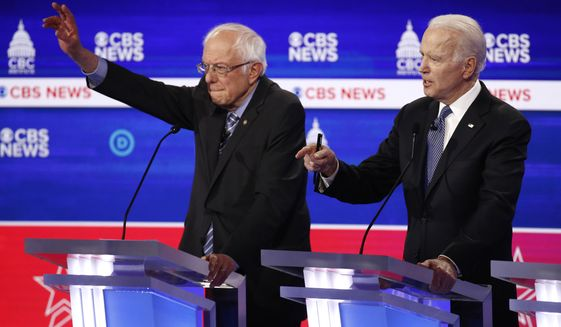 From left, Democratic presidential candidates Sen. Bernie Sanders, I-Vt., and former Vice President Joe Biden participate in a Democratic presidential primary debate at the Gaillard Center, Tuesday, Feb. 25, 2020, in Charleston, S.C., co-hosted by CBS News and the Congressional Black Caucus Institute. (AP Photo/Patrick Semansky)