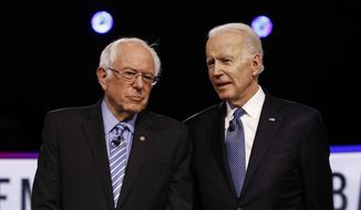 From left, Democratic presidential candidates, Sen. Bernie Sanders, I-Vt., former Vice President Joe Biden, talks before a Democratic presidential primary debate, Tuesday, Feb. 25, 2020, in Charleston, S.C. (AP Photo/Matt Rourke)