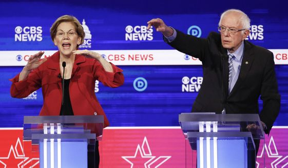 Democratic presidential candidates, Sen. Elizabeth Warren, D-Mass., left, and Sen. Bernie Sanders, I-Vt., right, participate in a Democratic presidential primary debate at the Gaillard Center, Tuesday, Feb. 25, 2020, in Charleston, S.C., co-hosted by CBS News and the Congressional Black Caucus Institute. (AP Photo/Patrick Semansky)