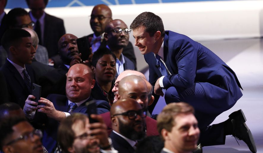 Democratic presidential candidate former South Bend Mayor Pete Buttigieg, poses for a photo after a Democratic presidential primary debate at the Gaillard Center, Tuesday, Feb. 25, 2020, in Charleston, S.C., co-hosted by CBS News and the Congressional Black Caucus Institute. (AP Photo/Patrick Semansky)
