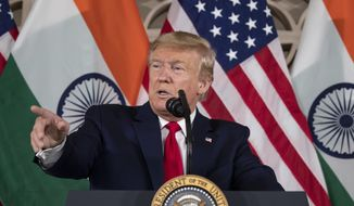 U.S. President Donald Trump speaks with business leaders at a roundtable event at Roosevelt House, Tuesday, Feb. 25, 2020, in New Delhi, India. (AP Photo/Alex Brandon)