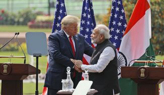 U.S. President Donald Trump and Indian Prime Minister Narendra Modi shake hands after giving a joint statement in New Delhi, India, Tuesday, Feb. 25, 2020. (AP Photo/Manish Swarup)