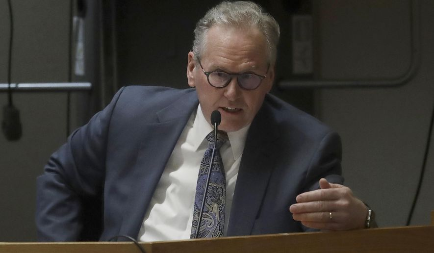 Pacific Gas & Electric CEO Bill Johnson gestures while testifying at the California Public Utilities Commission in San Francisco, Tuesday, Feb. 25, 2020. (AP Photo/Jeff Chiu)