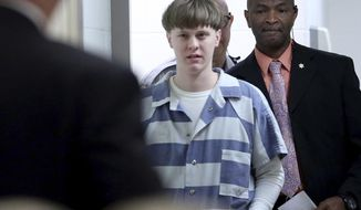 """In this Monday, April 10, 2017, file photo, Dylann Roof arrives to a courtroom at the Charleston County Judicial Center in Charleston, S.C., to enter his guilty plea on murder charges. The white supremacist church shooter staged a hunger strike in February 2020 while on federal death row, alleging in letters to The Associated Press that he's been """"targeted by staff,"""" """"verbally harassed and abused without cause"""" and """"treated disproportionately harsh."""" (Grace Beahm/The Post And Courier via AP, Pool, File)"""