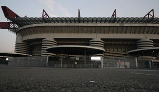 A view of the San Siro stadium where the Serie A soccer match between Inter and Sampdoria was cancelled, in Milan, Italy, Sunday, Feb. 23, 2020. In Lombardy, the hardest-hit region by the spread of the Coronavirus with 90 cases, schools and universities were ordered to stay closed in the coming days, and sporting events were canceled. Lombardy's ban on public events also extended to Masses in churches in the predominantly Roman Catholic nation. (AP Photo/Antonio Calanni)