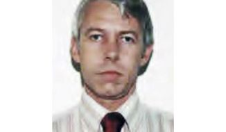 """FILE – This undated file photo shows a photo of Dr. Richard Strauss, an Ohio State University team doctor who was accused of sexual abuse by former athletes. Some of the men suing Ohio State over decades-old sexual abuse by the late team doctor are asking a judge to let the litigation resume after months of mediation haven't yielded a settlement. Lawyers for nearly half of the roughly 350 accusers who have sued wrote to U.S. District Judge Michael Watson on Monday, Feb. 24, 2020, arguing that the university has """"refused to engage in productive settlement talks"""" and hasn't participated in good faith.  (Ohio State University via AP, File)"""
