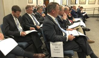Executives of Santee Cooper listen as the utility makes its presentation before the Senate Finance Committee on Tuesday, Feb. 25, 2020, in Columbia, S.C. Four executives did not show up because their lawyers advised them not to testify. (AP Photo / Jeffrey Collins)
