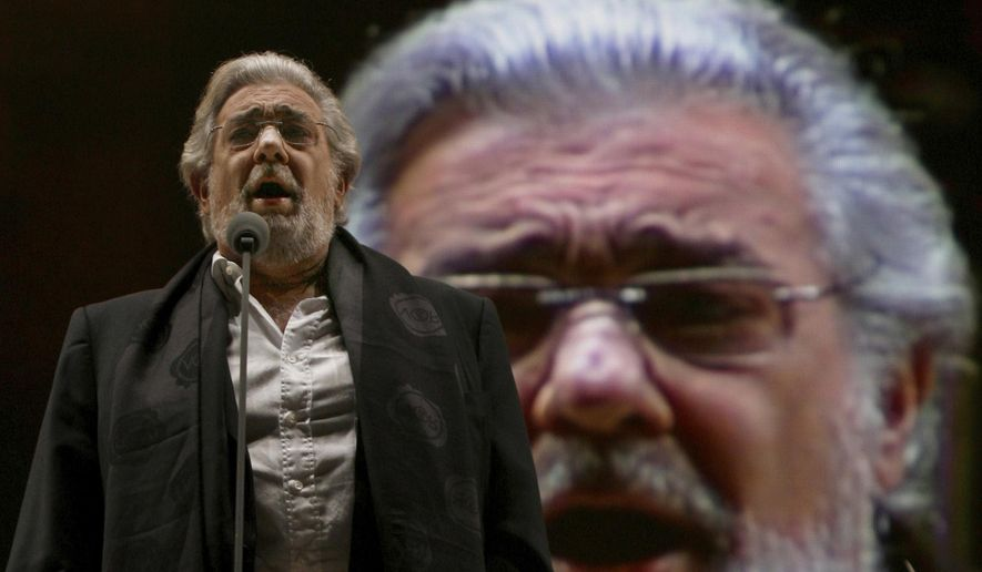 """FILE - In this Dec. 19, 2009, file photo, Placido Domingo performs during a sound check prior to a free concert in Mexico City. In a statement released on Tuesday, Feb. 25, 2020, he said, """"I have taken time over the last several months to reflect on the allegations that various colleagues of mine have made against me. ... I respect that these women finally felt comfortable enough to speak out, and I want them to know that I am truly sorry for the hurt that I caused them. I accept full responsibility for my actions, and I have grown from this experience."""" (AP Photo/Marco Ugarte)"""