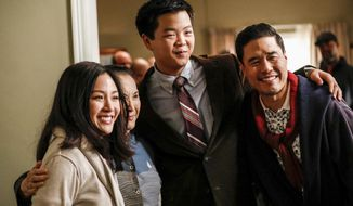 """This image released by ABC shows Constance Wu, from left, Lucille Soong, Hudson Yang and Randall Park in a scene from the series finale of """"Fresh Off the Boat,"""" which aired on Friday, Feb. 21. (Raymond Liu/ABC via AP)"""