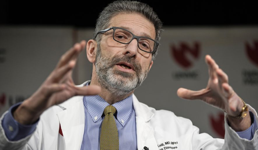 Dr. Andre Kalil, of the University of Nebraska Medical Center, speaks in Omaha, Neb., Tuesday, Feb. 25, 2020. Dr. Kalil, Kalil, who will oversee a clinical trial of the coronavirus at the medical center, said the study developed quickly in response to the virus outbreak that is centered in China. Patients who are hospitalized with the COVID-19, the disease caused by the virus, will be eligible to join the trial if they have at least moderate symptoms. (AP Photo/Nati Harnik)