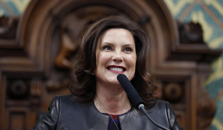 In this Jan. 29, 2020, file photo, Michigan Gov. Gretchen Whitmer delivers her State of the State address to a joint session of the House and Senate, at the state Capitol in Lansing, Mich. (AP Photo/Al Goldis, File)