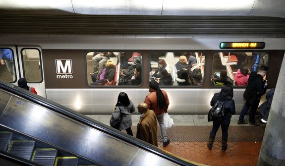 A Metro train arrives at the Gallery Place-Chinatown Metro Station, Thursday, Jan. 11, 2018, in Washington. Washington's Metro system has become internationally synonymous with delays, breakdowns and smoke-filled tunnels. (AP Photo/Alex Brandon) **FILE**