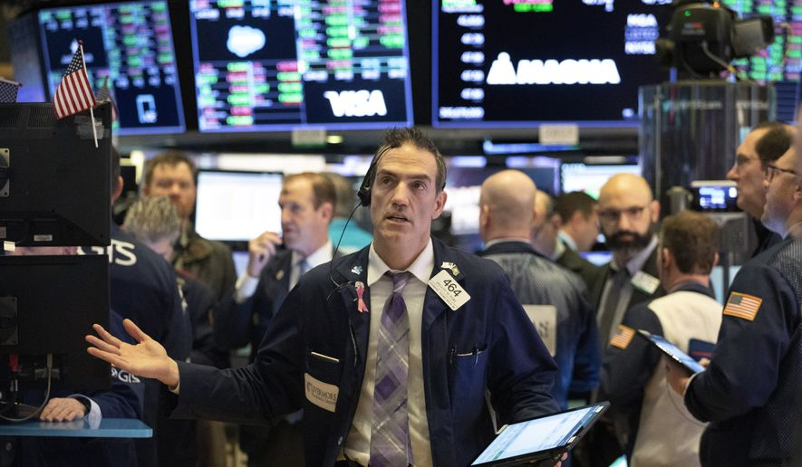 Stock trader Gregory Rowe works at the New York Stock Exchange, Wednesday, Feb. 26, 2020. (AP Photo/Mark Lennihan)