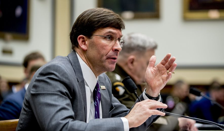 Defense Secretary Mark Esper, left, accompanied by Joint Chiefs of Staff Chairman Gen. Mark Milley, right, speaks at a House Armed Services Committee hearing on Capitol Hill, Wednesday, Feb. 26, 2020, in Washington. (AP Photo/Andrew Harnik)
