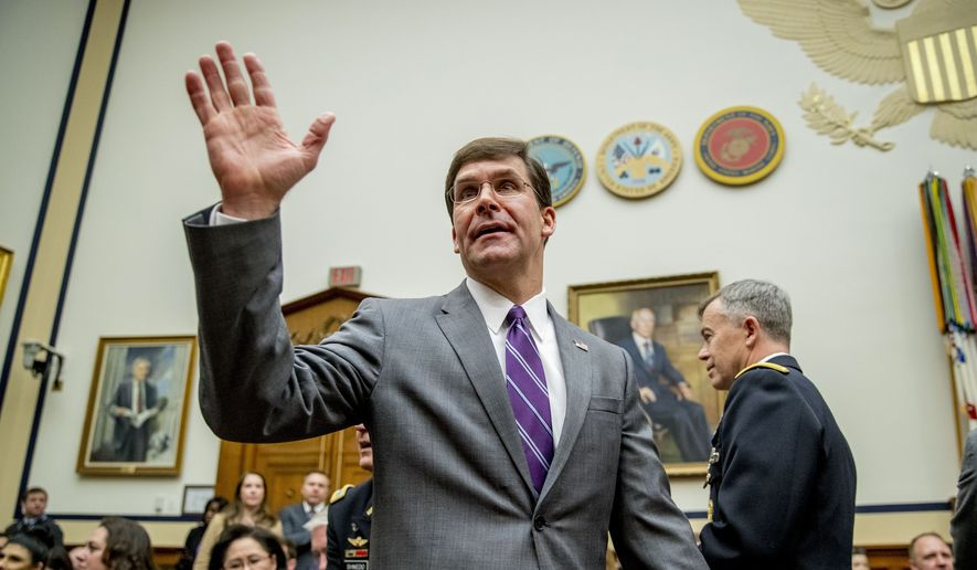 Defense Secretary Mark Esper arrives for a House Armed Services Committee hearing on Capitol Hill, Wednesday, Feb. 26, 2020, in Washington. (AP Photo/Andrew Harnik)
