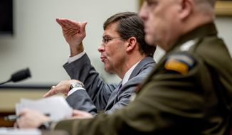 "Defense Secretary Mark Esper, accompanied by Gen. Mark A. Milley, chairman of the Joint Chiefs of Staff, told the House Armed Services Committee Wednesday that China remains the Defense Department's ""highest priority."" (Associated Press)"