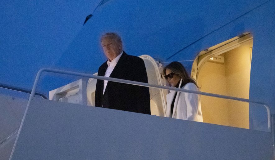 President Donald Trump, and first lady Melania Trump, step off Air Force One upon arrival, Wednesday, Feb. 26, 2020, at Andrews Air Force Base, Md. Mr. Trump is returning from India to fresh criticism from Democrats and in the media that his administration is ill-prepared for the ongoing coronavirus crisis. (AP Photo/Alex Brandon)