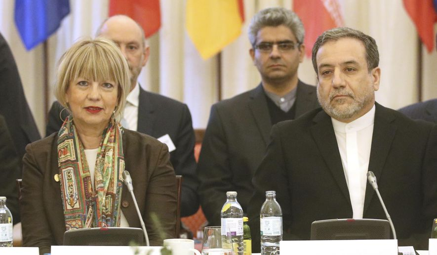 The European Union's political director Helga Schmid and Iran's deputy Foreign Minister Abbas Araghchi, from left, wait for a bilateral meeting as part of the closed-door nuclear talks with Iran in Vienna, Austria, Wednesday, Feb. 26, 2020. (AP Photo/Roland Zak)