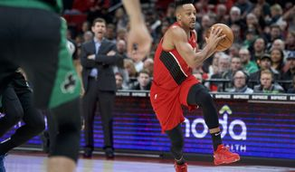 Portland Trail Blazers guard CJ McCollum drives to the basket against the Boston Celtics during the first half of an NBA basketball game in Portland, Ore., Tuesday, Feb. 25, 2020. (AP Photo/Craig Mitchelldyer)