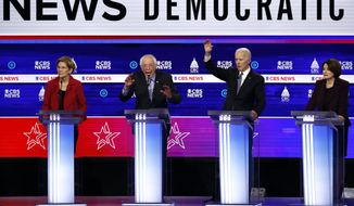 From left, Democratic presidential candidates, Sen. Elizabeth Warren, D-Mass., Sen. Bernie Sanders, I-Vt., former Vice President Joe Biden and Sen. Amy Klobuchar, D-Minn., participate in a Democratic presidential primary debate at the Gaillard Center, Tuesday, Feb. 25, 2020, in Charleston, S.C., co-hosted by CBS News and the Congressional Black Caucus Institute. (AP Photo/Patrick Semansky)