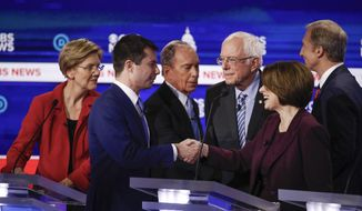 From left, Democratic presidential candidates, Sen. Elizabeth Warren, D-Mass., former South Bend Mayor Pete Buttigieg, former New York City Mayor Mike Bloomberg, Sen. Bernie Sanders, I-Vt., Sen. Amy Klobuchar, D-Minn., and businessman Tom Steyer, greet on another on stage at the end of the Democratic presidential primary debate at the Gaillard Center, Tuesday, Feb. 25, 2020, in Charleston, S.C., co-hosted by CBS News and the Congressional Black Caucus Institute. (AP Photo/Patrick Semansky)
