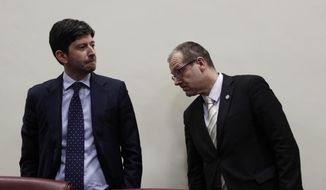 Italy's Minister of Health Roberto Speranza, and World Health organization Director for Europe Hans Kluge arrive for a press conference at the end of their meeting in Rome, Wednesday, Feb. 26, 2020. (AP Photo/Gregorio Borgia)