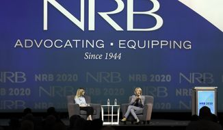 Education Secretary Betsy DeVos, right, speaks at the National Religious Broadcasters Convention Wednesday, Feb. 26, 2020, in Nashville, Tenn. At left is moderator Allie Stuckey. (AP Photo/Mark Humphrey)