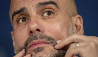 Manchester City head coach Pep Guardiola attends a press conference in Madrid, Spain, Tuesday, Feb. 25, 2020. Real Madrid will play against Manchester City in a Champions League soccer match on Wednesday. (AP Photo/Bernat Armangue)