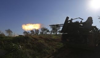Turkish backed Syrian fighter fires at a frontline near the town of Saraqib in Idlib province, Syria, Wednesday, Feb. 26, 2020. Syrian government forces have captured dozens of villages, including major rebel strongholds, over the past few daysin the last opposition-held area in the country's northwest. (AP Photo/Ghaith Alsayed)