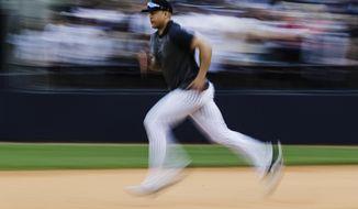 New York Yankees' Giancarlo Stanton runs during a spring training baseball workout Thursday, Feb. 20, 2020, in Tampa, Fla. (AP Photo/Frank Franklin II)