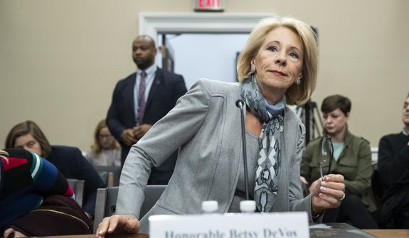 Education Secretary Betsy DeVos takes her seat to testify during a hearing of the House Appropriations Sub-Committee on Labor, Health and Human Services, Education, and Related Agencies on the fiscal year 2021 budget, on Capitol Hill, Thursday, Feb. 27, 2020 in Washington. (AP Photo/Alex Brandon)