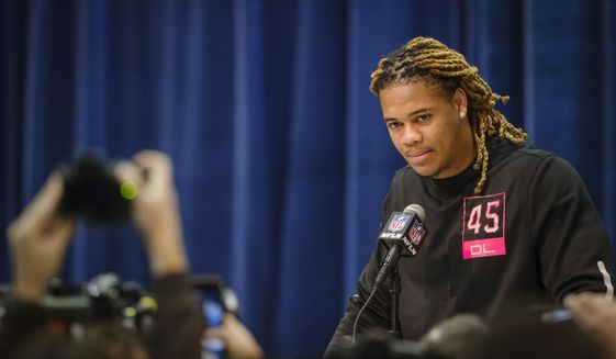 Ohio State defensive lineman Chase Young listens during a press conference at the NFL football scouting combine in Indianapolis, Thursday, Feb. 27, 2020. (AP Photo/AJ Mast)