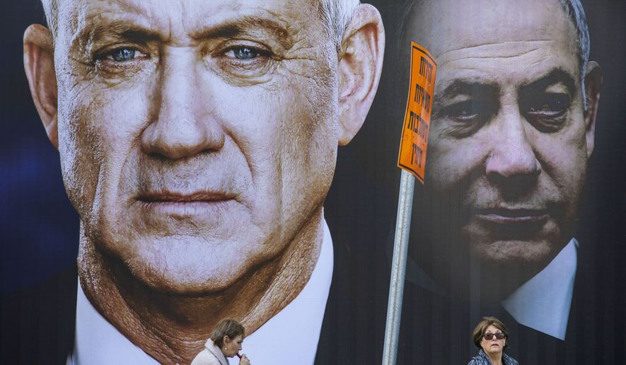 Campaign billboards for the Blue and White party's Benny Gantz (left) and Prime Minister Benjamin Netanyahu of the Likud party have become familiar sights in Israel over the past year. (Associated Press)