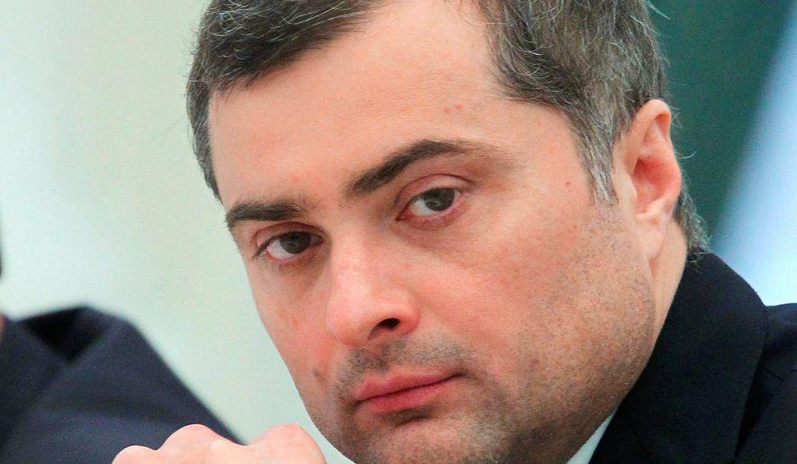 In this Wednesday, May 8, 2013, file photo, Vladislav Surkov, an adviser to Russian President Vladimir Putin listens, during a meeting in Moscow, Russia. (Mikhail Klimentyev, Sputnik, Kremlin Pool Photo via AP, File)